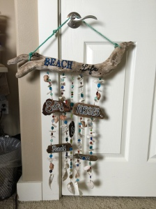 Beach Life wind chime. I used local driftwood, glass beads, and clam shell pieces.